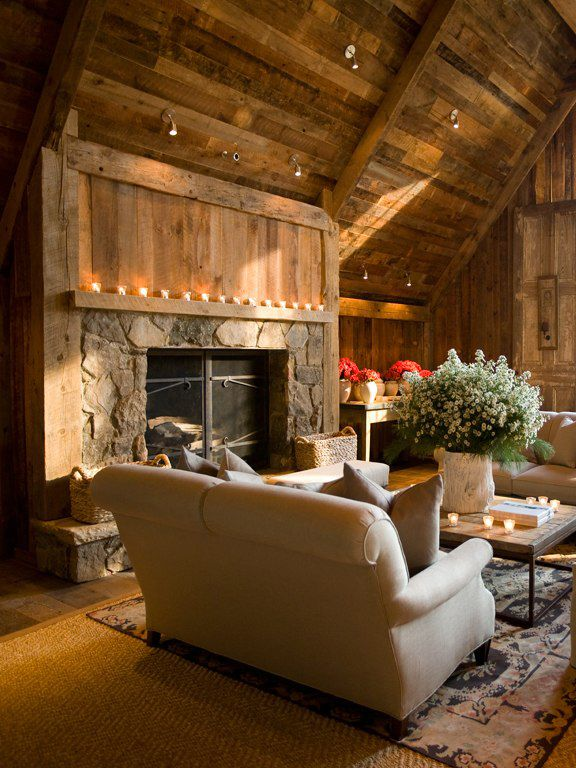 Rustic cabin living room features stone  wood  and candlelight mantled  fireplace259 best Chalets and Mountain Homes Interiors images on Pinterest  . Rustic Home Interior Design. Home Design Ideas