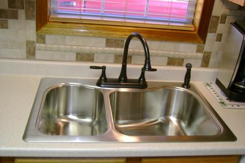 Kohler Staccato Large/Medium Self-Rimming Stainless Steel Sink with bronze faucet