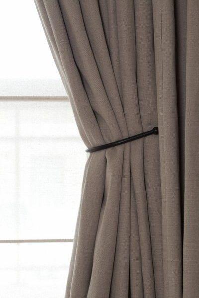 simple iron 'tiebacks' on taupe linen curtains - Bieke Vanhoutte
