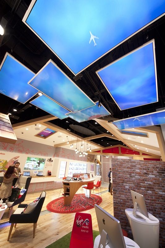 Digital Signage used to create ambience in the faux 'garden' within the store.