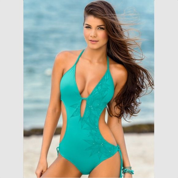 Turquoise push up Monokini swimsuit 36 Steal away to the coast and discover the Jewel of the Nile! This bathing suit features fabulous silvery jewels in a pattern to accentuate the shape of your curves. Halter top ties around your neck with removable padding to adjust to your comfort and push up level. Its tie back and adjustable string bottom are tailored to fit your shape. Triangle halter top offers support. Removable padding to select your level of push up. Will fit cups B/C Sultry silver…