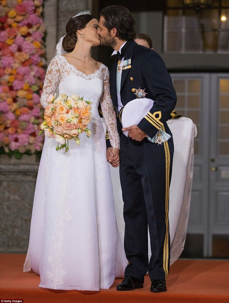 Beautiful: Prince Carl Philip of Sweden (right) kisses his new wife Princess Sofia of Sweden (left) after their marriage ceremony at The Royal Palace in Stockholm, Sweden