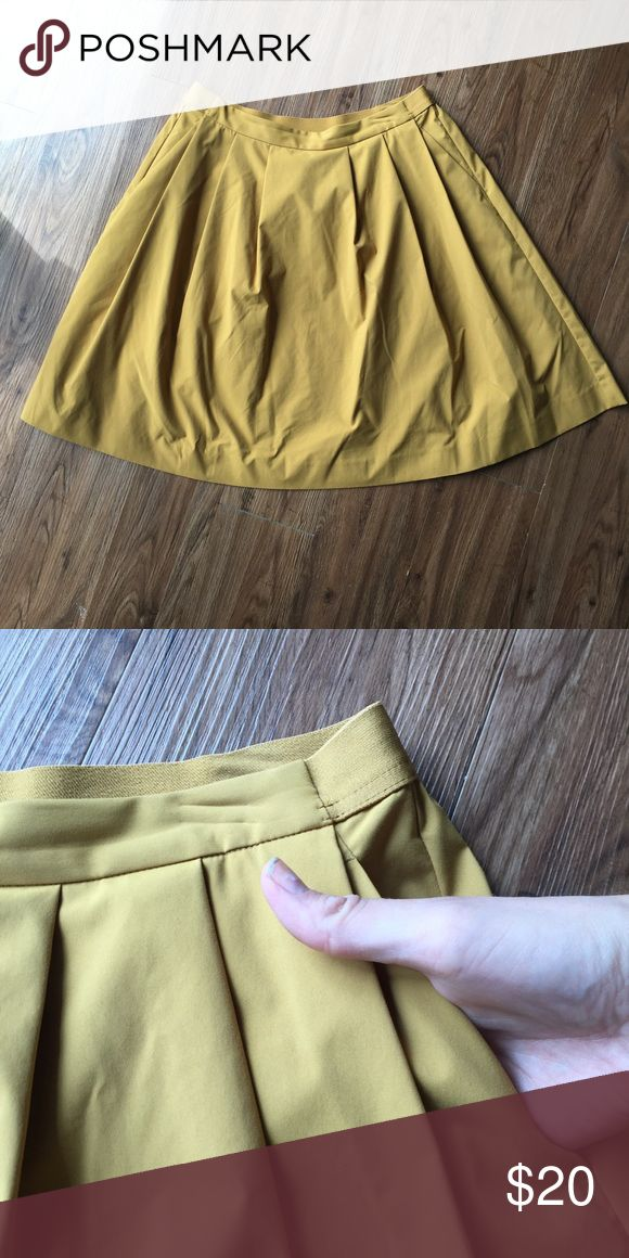 Uniqlo Mustard Yellow Pleated Skirt Uniqlo. High waisted A-line pleated skirt. With pockets. Uniqlo Skirts A-Line or Full