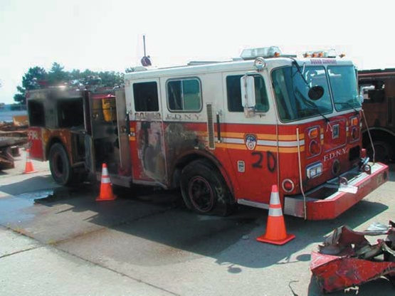 This truck was one of the last FDNY fire engines recovered at the World  Trade Center after September 11, 2001.  The highly trained unit of Squad 252 boarded the engine and raced toward lower Manhattan.      All six men - one officer and five firefighters - were lost that morning.