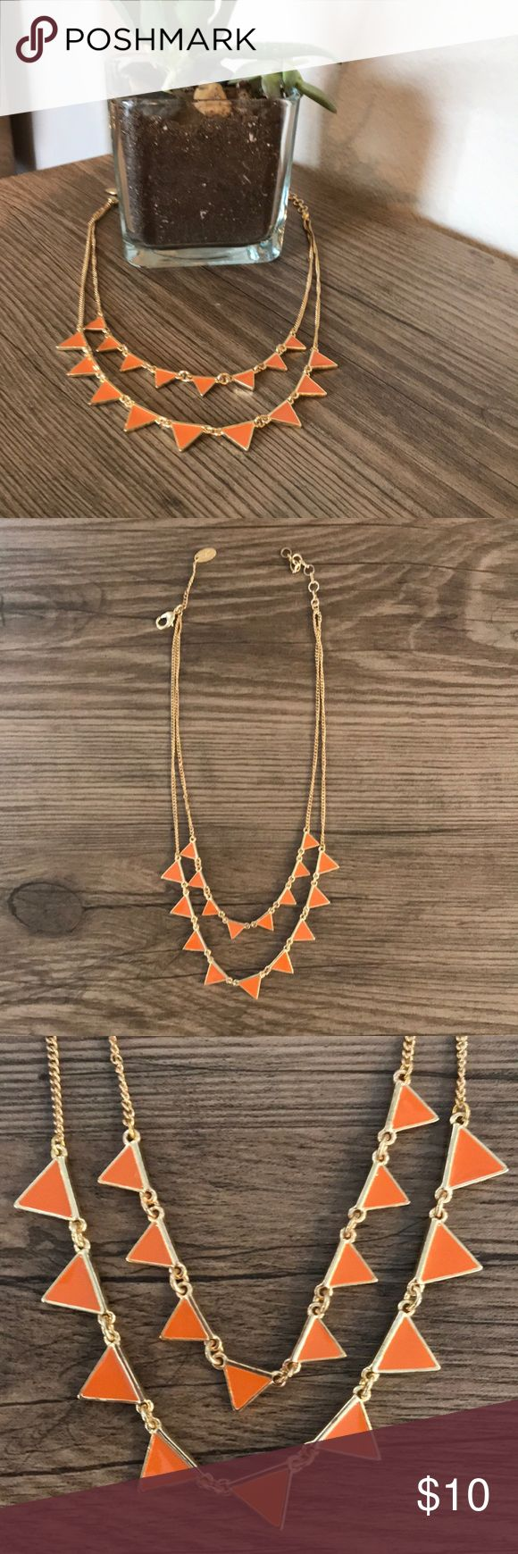 "Double Stranded Gold and Orange Layered Necklace SELLER DISCOUNT - 15% OFF 2+ items!  Add this double strand layered necklace with orange geometric details to your jewelry box today!  Color: goldtone multi strand chain with orange enamel triangle accents  Length: shorter chain is approx 15"" with extender, longer chain is approx 18""  Former fashion buyer and active Posher since 2015! Adult owned, smoke-free home. I take care of my merchandise; it is in excellent condition (unless specifically…"