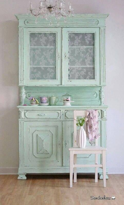 Pretty hutch in mint green with lace panels in the doors