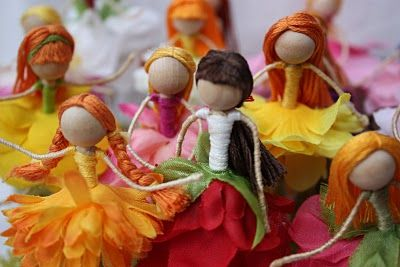 These flower fairies are made from fake flower pedals, floral wire and embroidery floss.... each one original...every fairy has a unique dress and hairdo.