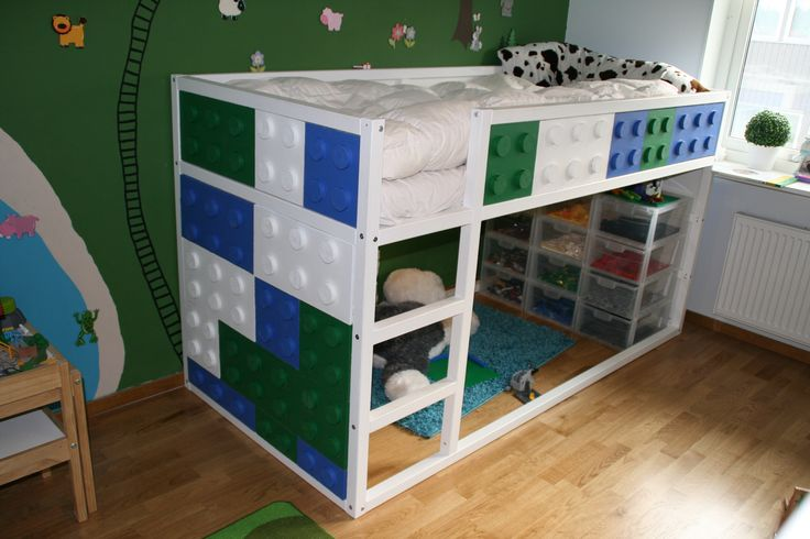A kids bed with Lego!  sweet!!!   tristan would have loved this when he was younger...lol  who am i kidding, he would STILL love this!!!  =)