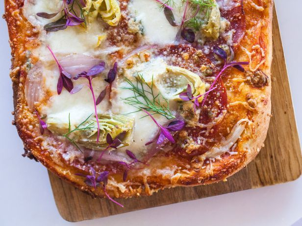 Cheesy Meaty Pizza - combines tomato sauce, Calabrese salami, capocollo salami, Ciliegine mozzarella balls, artichoke hearts, fennel, shallots, blue cheese, grated Parmesan and, for an extra-springy touch, pretty microgreens — easy to find in the supermarket