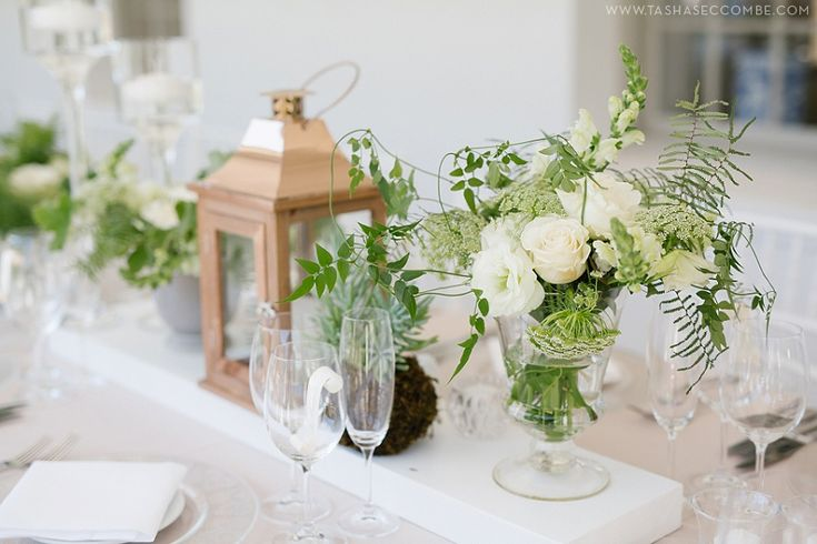Flowers in the foyer green and white table decor. Photo by Tasha Seccombe