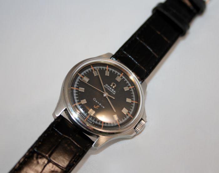 Omega - Geneve Admiralty Ancoretta - Heren - 1960-1969  Omega Geneve Admiraliteit Ancoretta horloge.Automatisch uurwerk.Stalen kast meten van 35 mm in diameter.Grote originele Omega kroon.Zwarte wijzerplaat.Plexiglas kristal.Waterbestendig: 30 m.Leerriem meten van 21 mm gemaakt in Italië.Omega stalen gesp.  EUR 0.00  Meer informatie  #watch