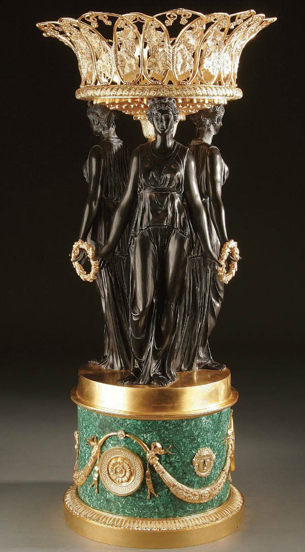 """A pair of magnificent bronze malachite urns. Both urns feature three identical graces in bronze. Ca1950. 36""""H x 16""""D."""