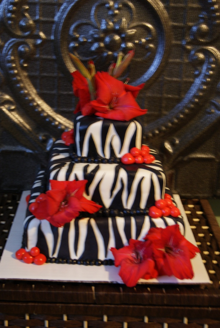 I think this would look cute with the flowers as wedding colors then leave the cake part black and white.