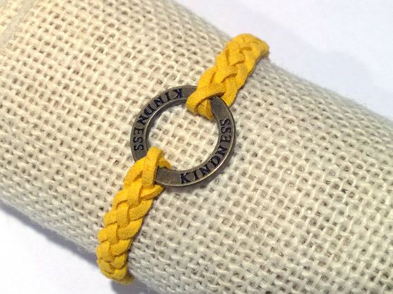 To Polish Or Not? There can never be too much kindness in the world!  This yellow faux suede braided bracelet is youthful and fun. It is light, smooth and soft on