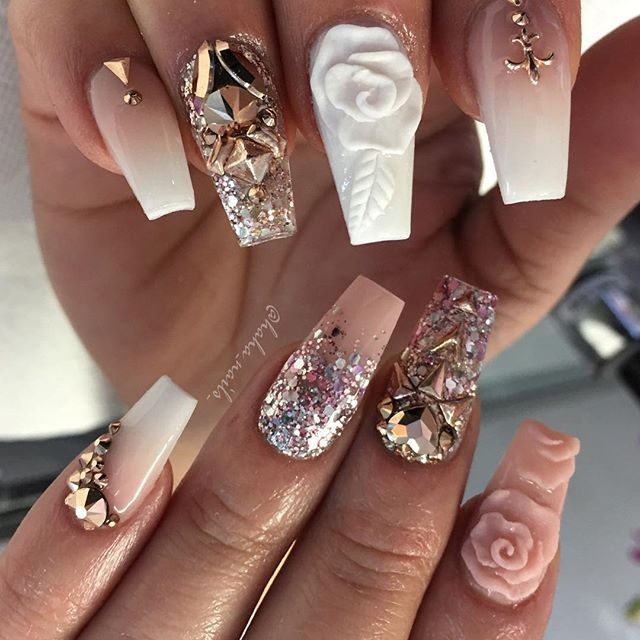 Gorgeous flower, glitter and jeweled manicure