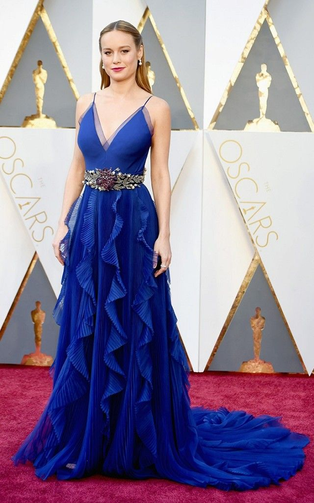 Brie Larson wears a blue ruffled Gucci dress with a jeweled belt.