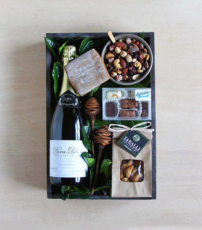 A lovely bottle of Champagne accompanied by hand-picked treats: 'Sparkling Crate' by Winston Flowers.