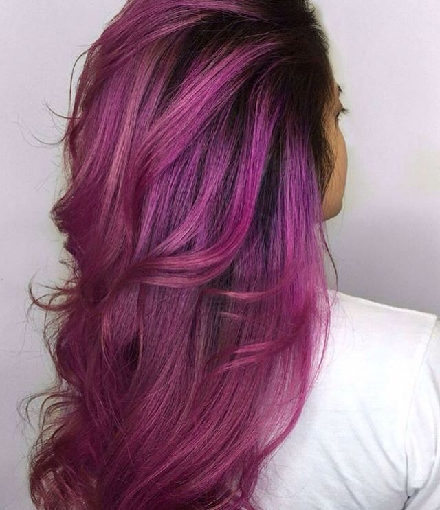 Rooted vivid magenta purple pink hair color.