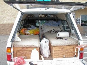 several good ideas here - running power from the car battery, sink, camper shell locks.