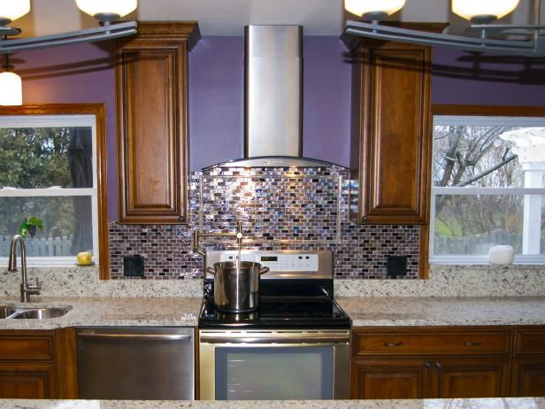 Purple and Brown Kitchen With Iridescent Backsplash  Make a room memorable with a surprising element, like the iridescent purple tile backsplash in this kitchen on HGTV.com.