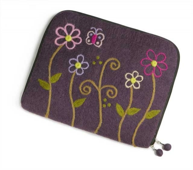 The ideal gift for a lady who has almost everything, a beautiful felt laptop case in purple with a subtle floral design.  From Norway.