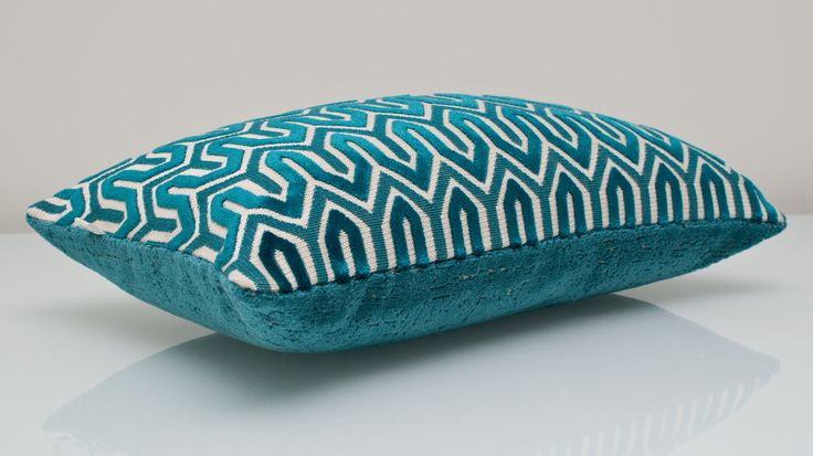 Blue Pillow available at Threadsandmore.ca An elegant lumbar cushion that is an epitome of luxury. This exclusive design boasts a textured front and a solid peacock blue back. The peacock blue colour is a modern take on regular blue.