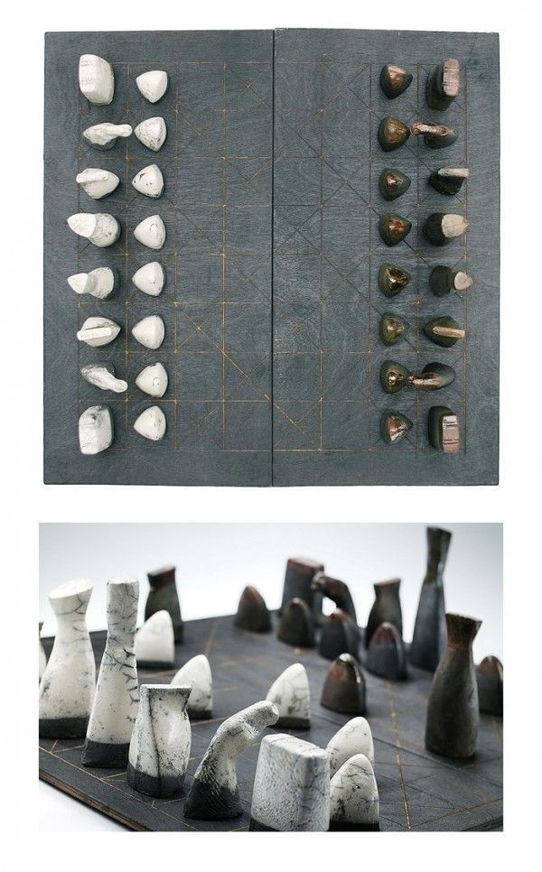 Ceramic chess pieces, set out on this intriguing board of black burnt plywood, will bring a mystical stone age appeal to any space-perfect for a traditional library.