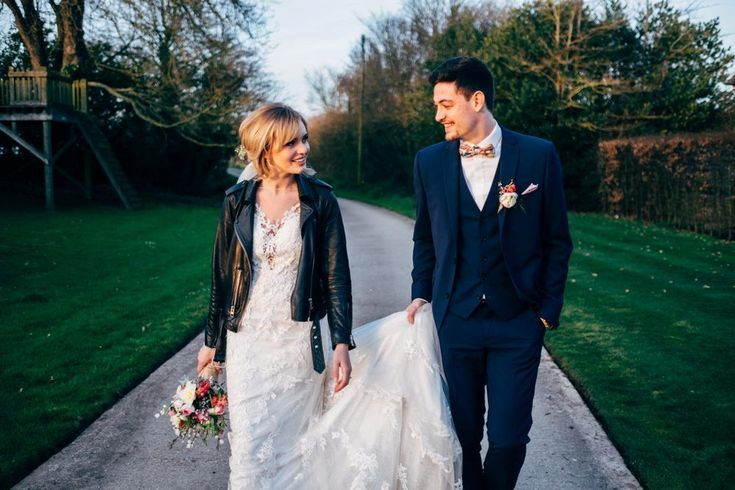 Bride in Leather Jacket & Benjamin Roberts 2650 Lace Wedding Dress | Dale Weeks Photography | Spring Wedding at Southend Barns in Chichester  | Seasonal Bright Flowers from Sussex Flower Farm | ASOS Bridesmaid Dresses | Monsoon Flower Girl Dress