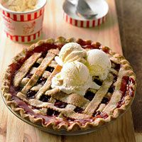 Pastry for Double-Crust Pie or one 15-ounce package rolled refrigerated unbaked piecrusts (2 crusts)  2 14 1/2ouncecanspitted tart red cherries (water pack)  1 1/2 cupssugar  1/4 cupcornstarch  1/2 teaspoonground cinnamon  1 tablespoonbutter  1/2 teaspoonalmond extract