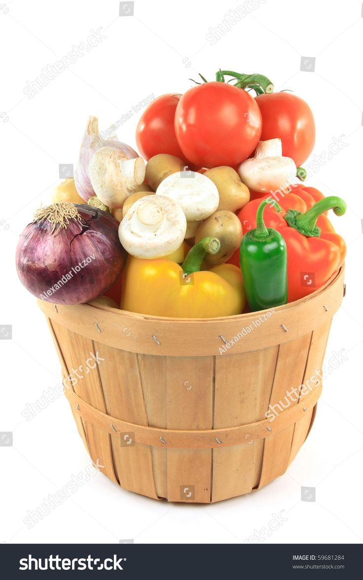 Still picture of different vegetables and ingredients - pepper, potatoes, tomatoes, garlic, onion, mushrooms, Jalapeno  in wooden basket bushel over white background.