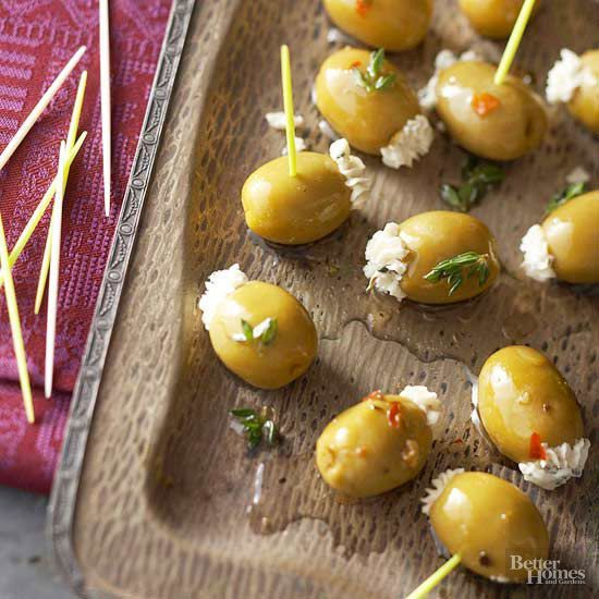 Finishing an easy party appetizer is as simple as one, two, done! Step 1: Mix cream cheese, Gorgonzola cheese, and herbs with an electric mixer. Step 2: Pipe into olives. You're done! http://www.bhg.com/recipes/party/appetizers/new-years-party-appetizer-recipes/?socsrc=bhgpin122914gorgonzolathymestuffedolives&page=3
