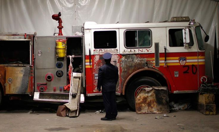 A New York City Fire Department engine recovered from the World Trade Center disaster site sits inside Hangar 17 at New York's John F. Kennedy International Airport, on June 16, 2011.