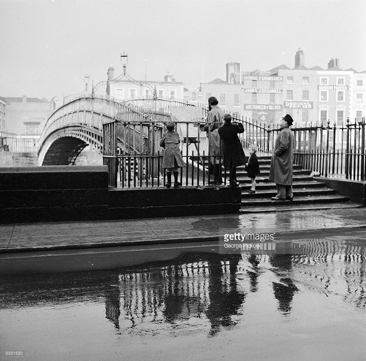 A traditional steel-spiked footbridge crossing the River Liffey in Dublin.
