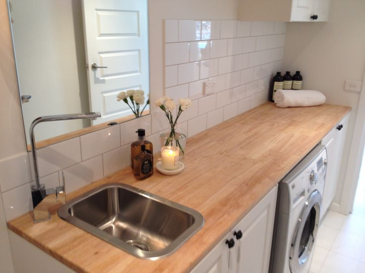 This one is my favourite laundry inspired - tile, bench material and size, sink placement, mirror etc. cupboard colour is nice but could be a different colour - same as what the kitchen island or bathroom cupboard is to tie it together laundry - bench top, tiles, cupboards, knobs