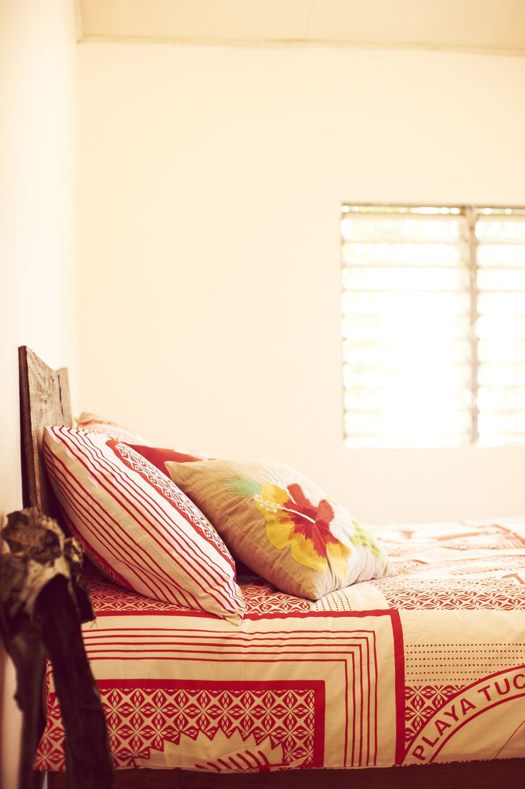 Bed room, lovely white and red duvet cover! Awake with a smile!