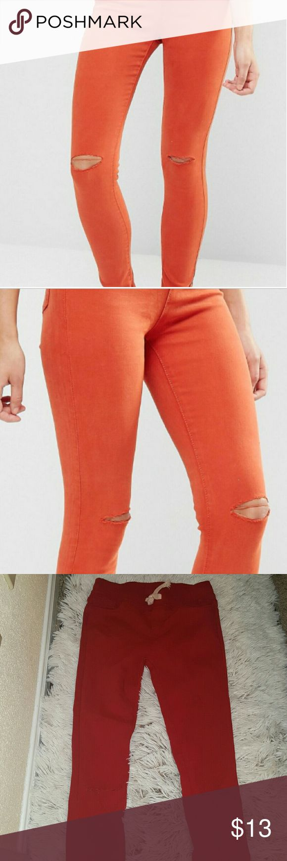 red orange skinny jeans Stretch Glamorous Skinny Jean ripped knee...the model pic is just an example of the jeans .. the original color of the jeans is red orange fashion house Pants Skinny