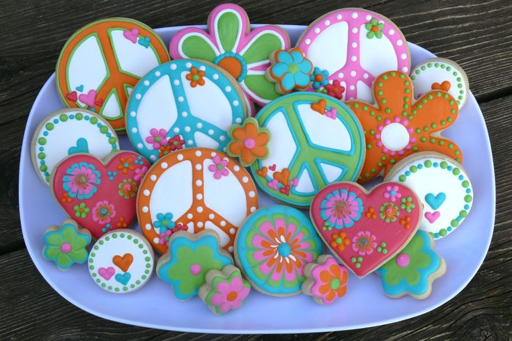 Decorated cookie platter made for a Scooby-Doo themed birthday party...peace signs, hippie, love, flowers, tie dye, hearts, 70s, cartoon www.facebook.com/cookiesbycharity