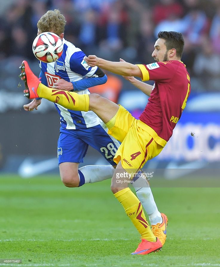 Fabian Lustenberger of Hertha BSC heads the ball against Lukas Rupp of SC Paderborn 07 during the game between Hertha BSC and SC Paderborn 07 on april 5, 2015 in Berlin, Germany.