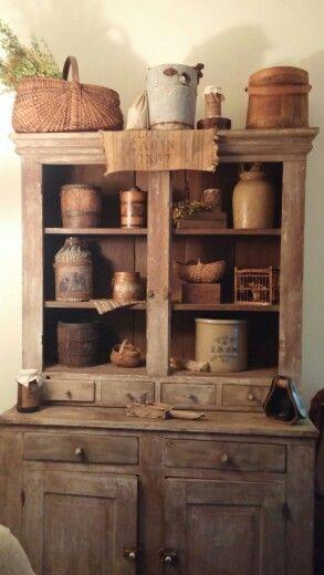Primitive stepback cupboard