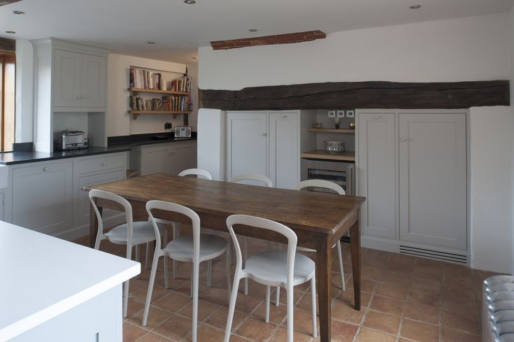 TIMELESS CONTEMPORARY    THE BRIEF Light, airy and lots more storage. A range cooker please. A walk in larder. An island. A tall fridge, a freezer, a table and chairs of a very young family. Warm and friendly. Watch the budget. Help?!