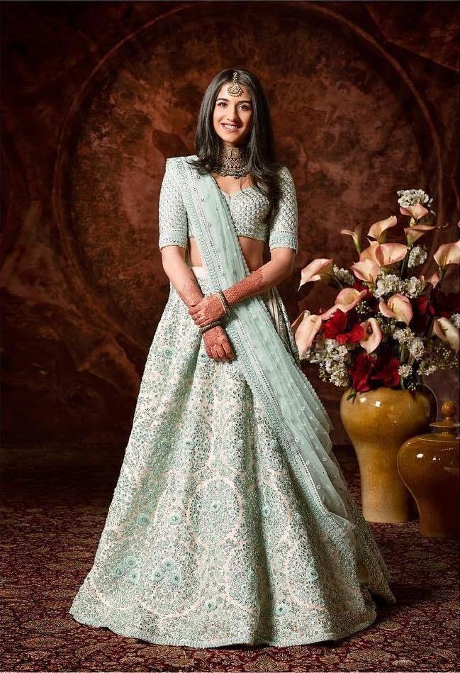 700b034f96 Radhika Merchant in a light blue Sabyasachi lehenga for Ambani Wedding.  #Frugal2Fab