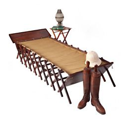'Wheelers Cot,' which was sold at one time at Harrod's. There is more such stuff at www.jandrguram.com