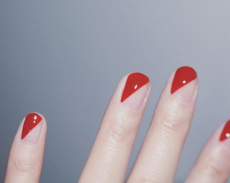 These bold red triangle nails ooze 80s vibes. Keep the other side free of coloured polish and gloss over with topcoat.