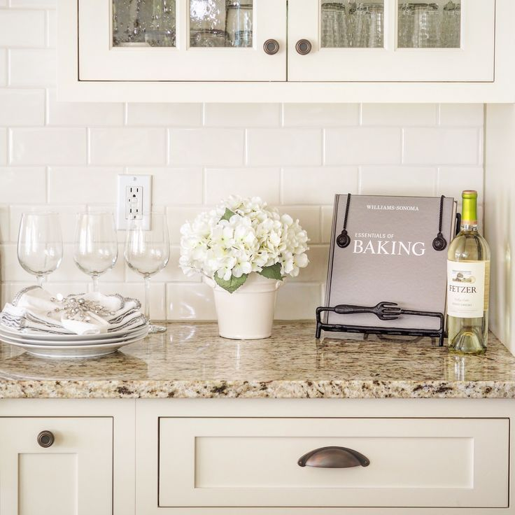 Venetian Gold Light Granite with off white subway tile and off white cabinets.
