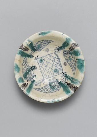 An Abbasid pottery bowl with bands