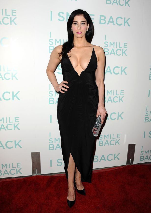 Sexy Sarah Silverman takes the plunge in a VERY low-cut black dress