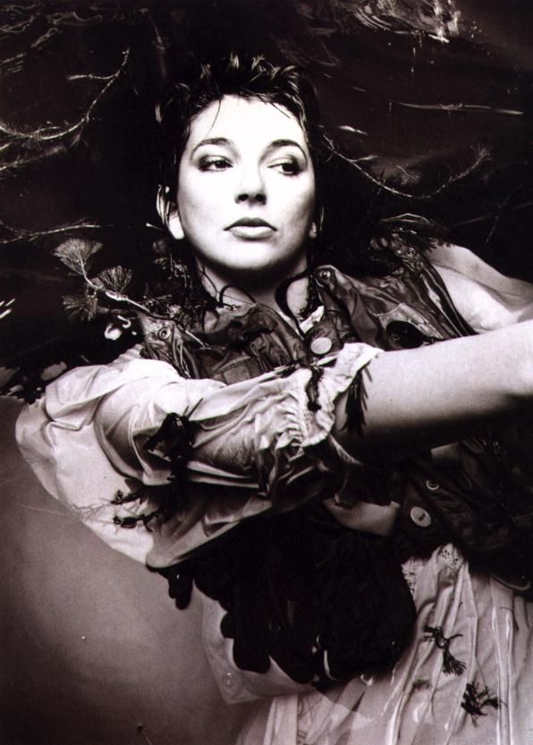 """Kate Bush  - """"With just one hand, held up high.  I can blot you out of sight.  Peek-a-boo, peek-a-boo.  Little Earth""""."""