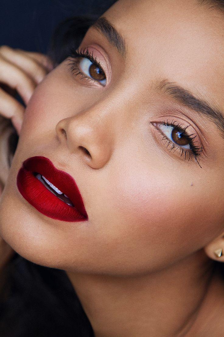 Red lip and natural eyes.