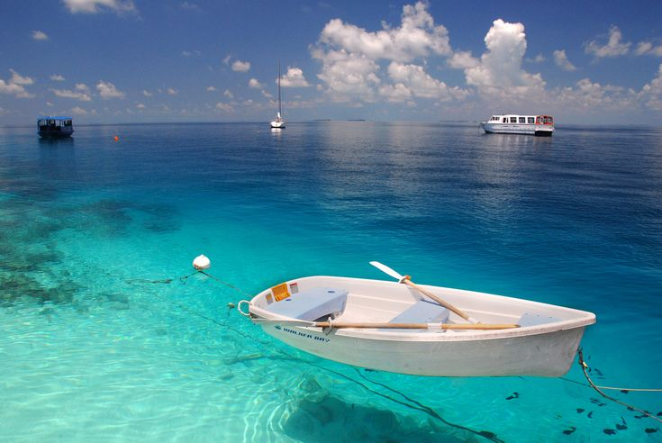 The beautiful clear water of Maldives with the little white boat, ahhh