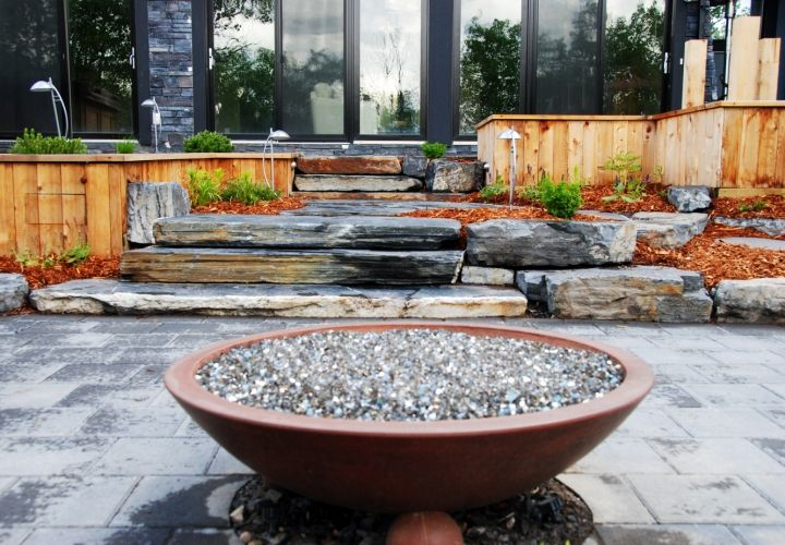This visually interesting fire bowl is perfect as a conversation piece. It provides hours of warmth and enjoyment for entertaining or for a peaceful evening with family. #firebowl #custombackyard